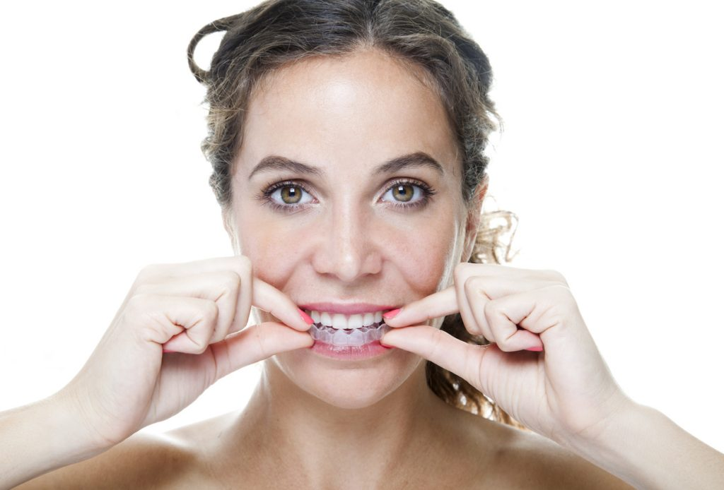woman-wearing-retainer-to-avoid-teeth-shifting